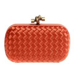 Bottega Veneta in bright orange with gold hardware