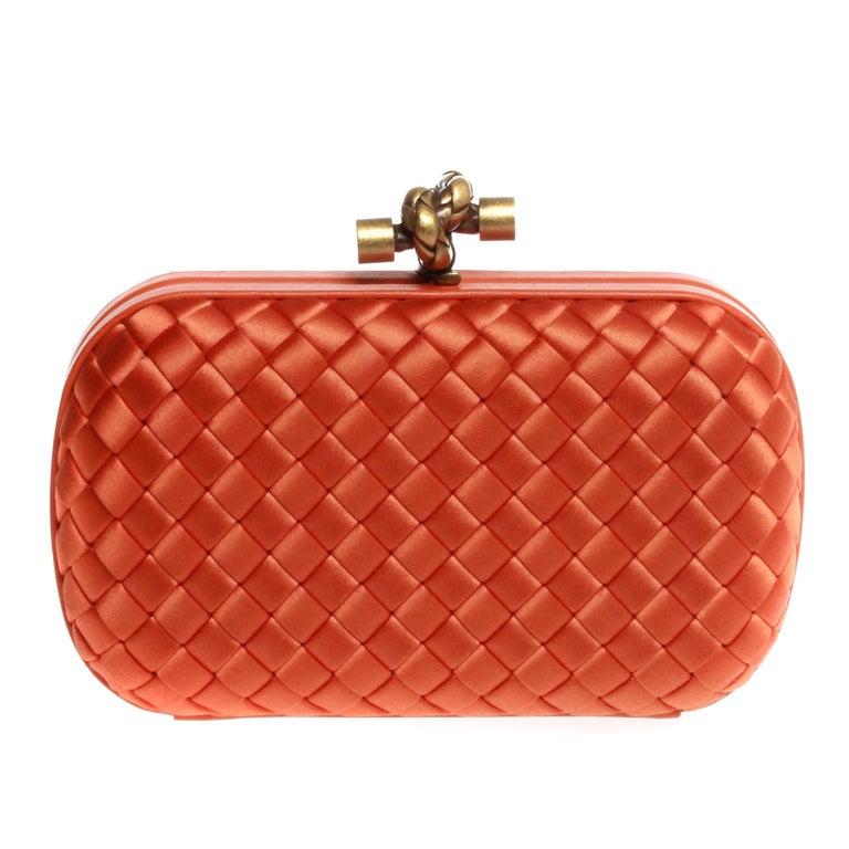 Bottega Veneta in bright orange with gold hardware