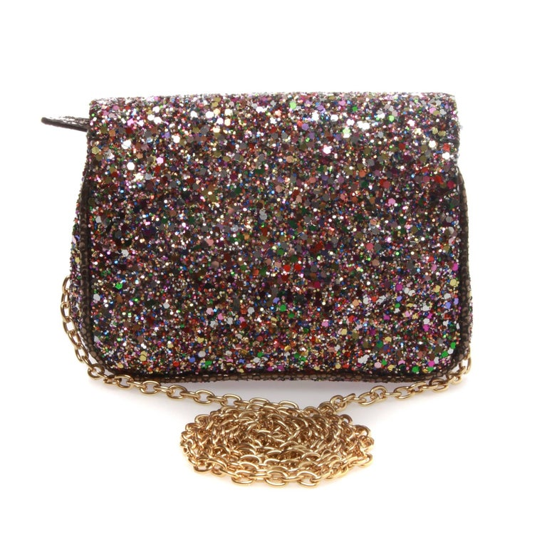 JIMMY CHOO Caro Glitter Clutch  Jimmy Choo's perfectly petite glitter clutch.  Colourful sparkles and gold mesh detail lend an eye-catching note to cocktail dresses and evening gowns alike. Removable chain-link shoulder strap. Gold-toned top zip,