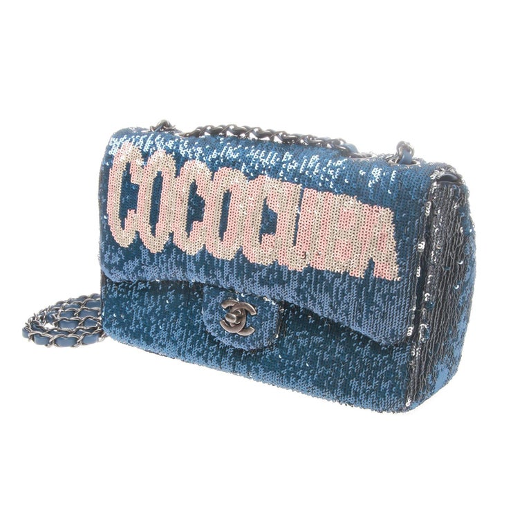 Rare and incredibly sought after Chanel bag from the Cruise 2017 collection. Rendered in dynamic blue and gunmetal two-tone sequins with a feature 'COCOCUBA' graphic on the front flap inspired by the city lights of Havana.   Medium flap bag features