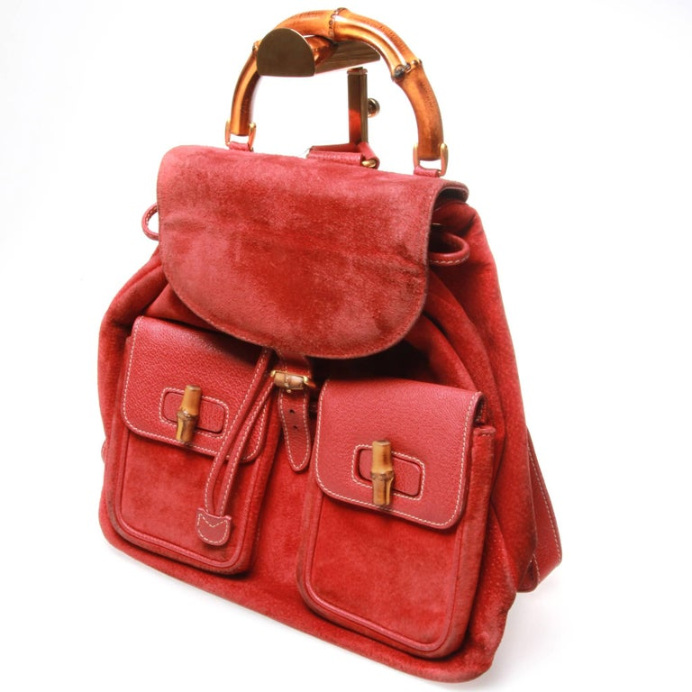 d98e0b45f4406 Red suede Gucci Vintage Bamboo backpack with gold-tone hardware