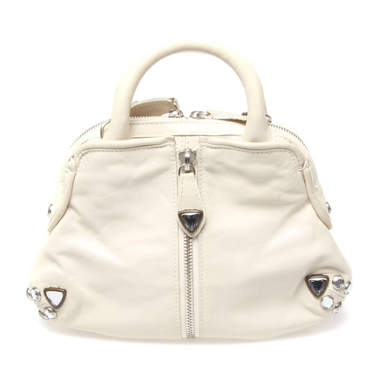 Sonia Rykiel handbag in white leather featuring silver hardware and zip flap opening design feature. Comes with strap.