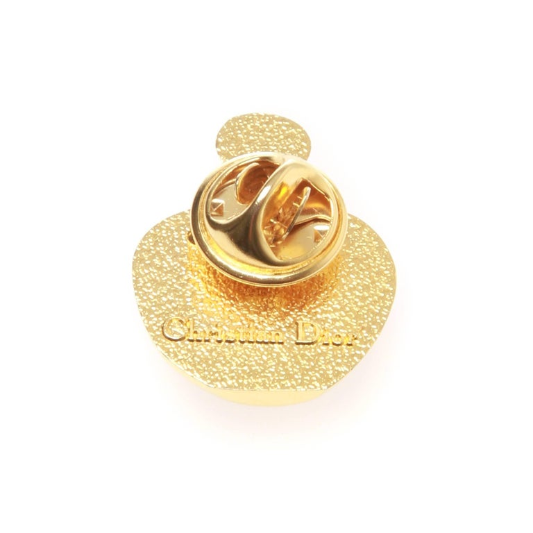 A fabulous vintage gold-tone poison bottle brooch made in the 80's by Christian Dior.