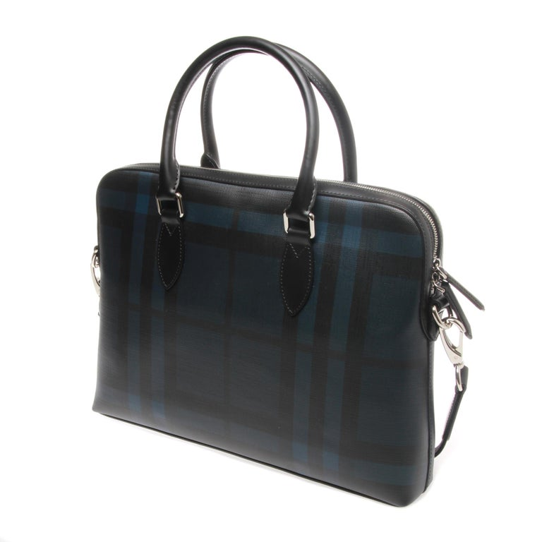Burberry London Check Collection Barrow Simple Briefcase  A Burberry signature London check coated canvas body briefcase with calfskin leather trim, silver tone hardware, double top handles, adjustable and detachable shoulder strap and zip top
