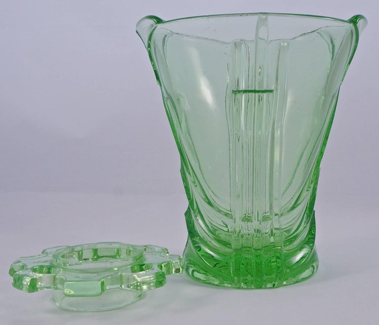 Bright green Art Deco vase made from pressed glass with removable flower frog/holder. Measuring height 14.5cm (5.7 inches) by maximum diameter 13.3cm (5.2 inches). The vase has a lovely Art Deco chevron and line design, and a thick glass base. There