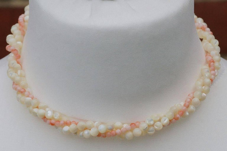 a8c959b48ec92 Twisted Triple Strand Coral and Mother of Pearl Bead Necklace
