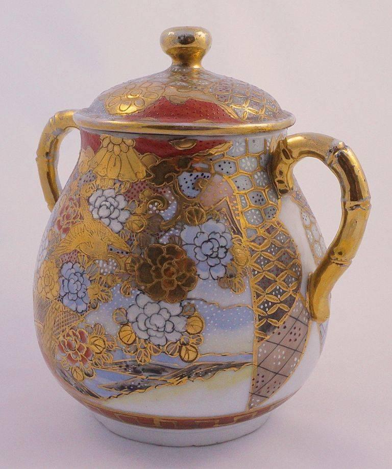Dai Nippon beautiful gold, blue and terracotta hand painted porcelain jar, from the Meiji period 1868 - 1912. Measuring height 14cm, 5.5 inches, by maximum 15.2cm, 6 inches width. The jar is decorated with a scene depicting birds and flowers. There