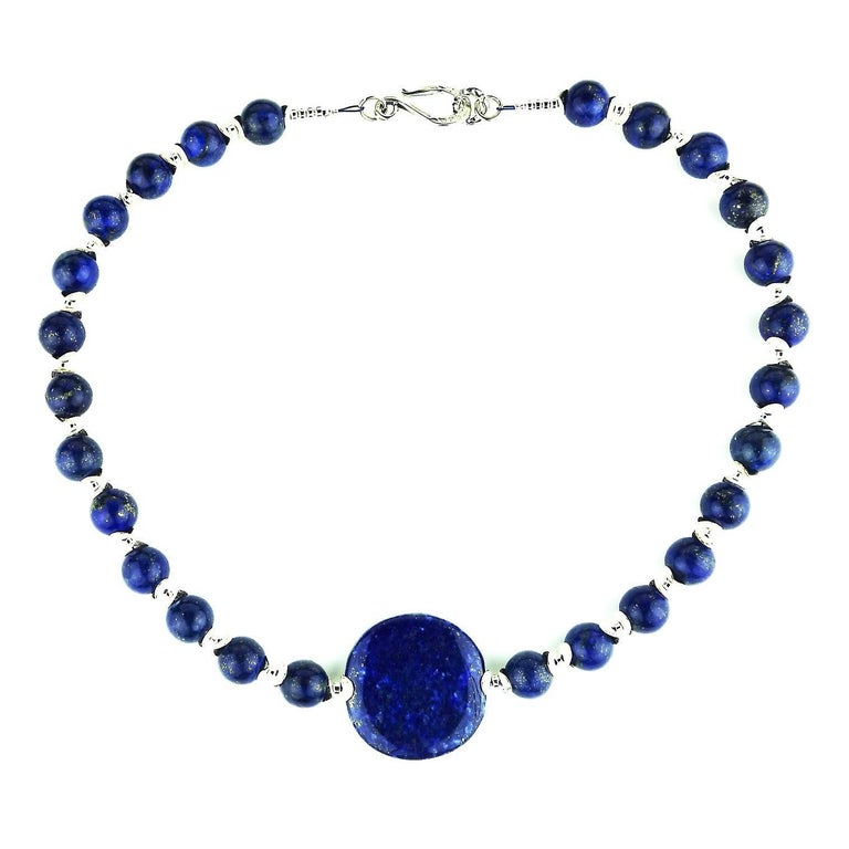 Beautiful 12mm blue Lapis Lazuli beads with a Lapis Lazuli disc focal of 35mm necklace.  This is a lovely Blue, blue necklace with lots of silver accents including a Sterling Silver hook style clasp. 20 inches in length.  More from this seller by