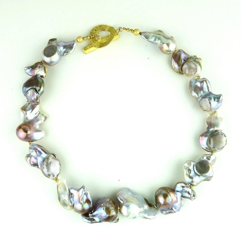 Gorgeous, large, silver Baroque Pearl necklace. These Baroque Pearls are unique in color and shape, each is a gem on its own. They iridesce in shades of pink, green and a touch of bronze.  The largest pearl measures 32x26MM.  The necklace measures