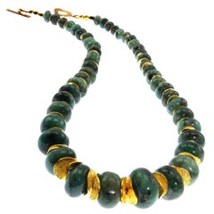 Necklace of Highly Polished Graduated  Green Emerald Rondels with Gold Accents