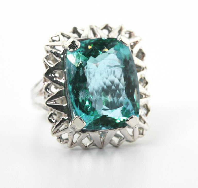 Super brilliant glittering 8.25 carat Aquamarine (14.88 mm x 11.6 mm) set in a sterling silver ring size 5 (sizable).    More from this seller by putting gemjunky into 1stdibs search bar.