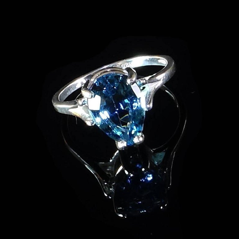 Custom made, sparkling, Pear shape, Deep Sky Blue Topaz in Sterling Silver ring.  The  Split shank mounting  enhances the brilliance of this unique gemstone.  This lively Blue Topaz is 3.31 carats of sparkle.  Size 7. Topaz is the November