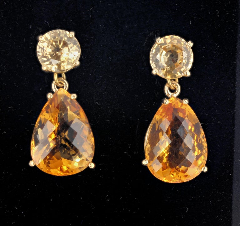 15.35 carats of of Citrines dangle elegantly from glittering yellow 5.2 carats of Cambodian Zircons set in 10Kt yellow gold stud earrings that hang approximately 1.1 inches long.