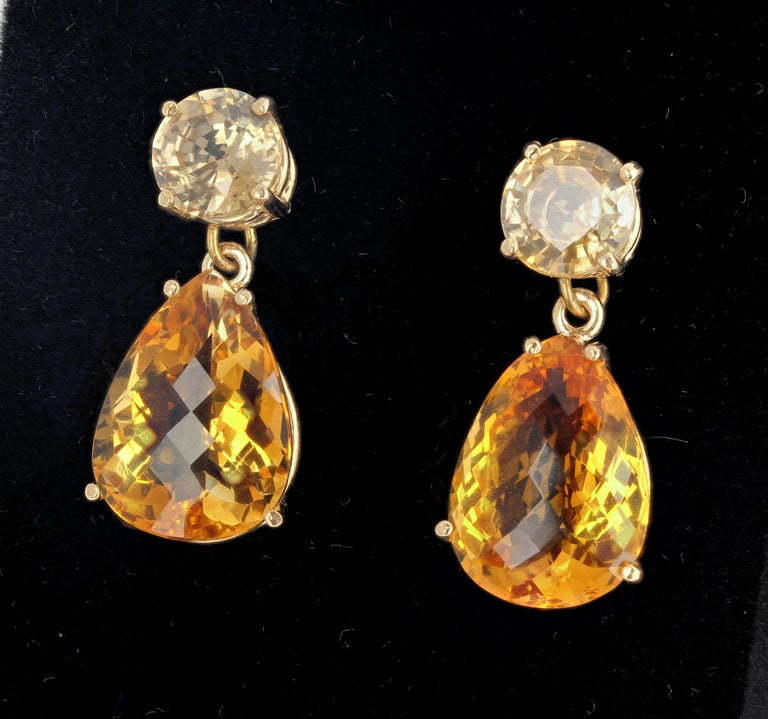 15.35 carats of of Citrines dangle elegantly from glittering yellow 5.2 carats of Cambodian Zircons set in 10Kt yellow gold stud earrings that hang approximately 1.1 inches long.   More from this seller by putting gemjunky into 1stdibs search bar.