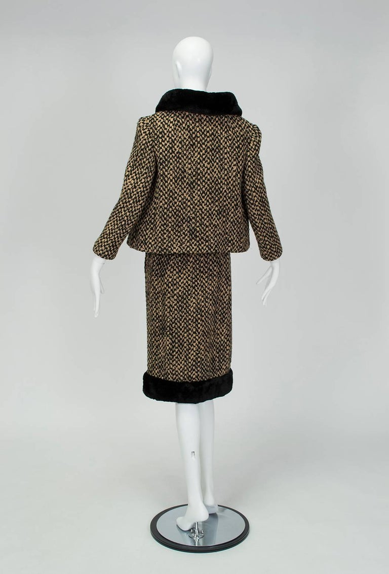 Brimming with luxurious details like powder-soft sheared mink, a Balenciaga-style stand-away collar and a matching cap sleeve top, this Camelot-era stunner is nothing short of a time bomb. Hand-finished and lined in supple silk crèpe, it would be