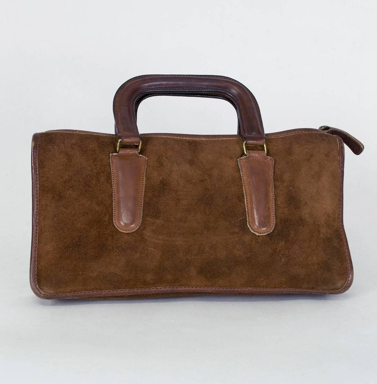 Right in between a proper briefcase and a top handle purse, this ultra-practical (it is Bonnie Cashin, after all) tote is large enough to carry an iPad Mini but small enough to keep you from looking like a bag lady. The best part? The heavyweight