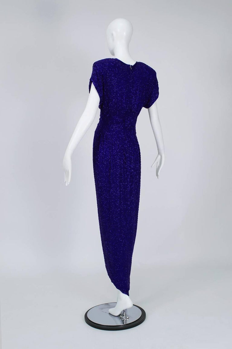 Smouldering with sensuality, this cap sleeve gown has