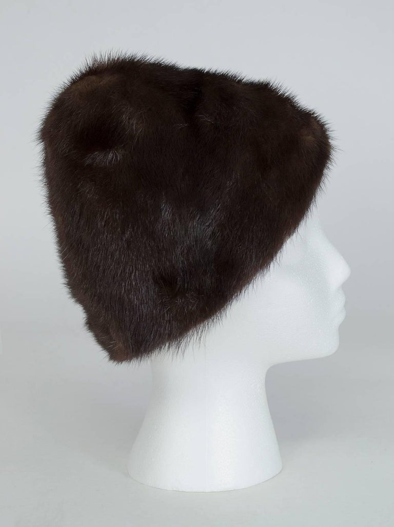 Peak hats immediately conjure the image of a young Audrey Hepburn, and this one is no exception. In supple inky brown (almost black) mink fur, this is a hat that will make you stand a little straighter, walk a little taller, and add a few inches to