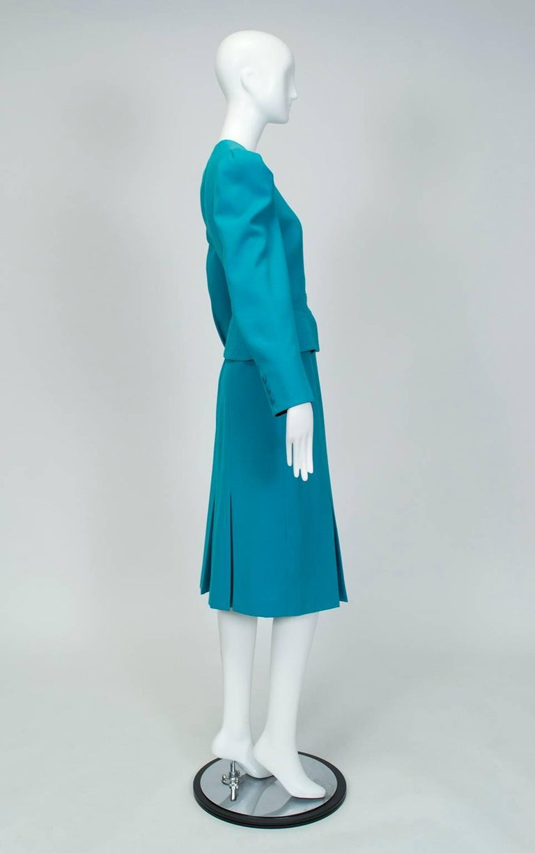 From its striking color to its seductive neo-40s silhouette, this is a suit unafraid to make a bold impression...which makes sense when you realize it belonged to the wife of one of the most notorious mafiosi in American history.  Wool crêpe suit