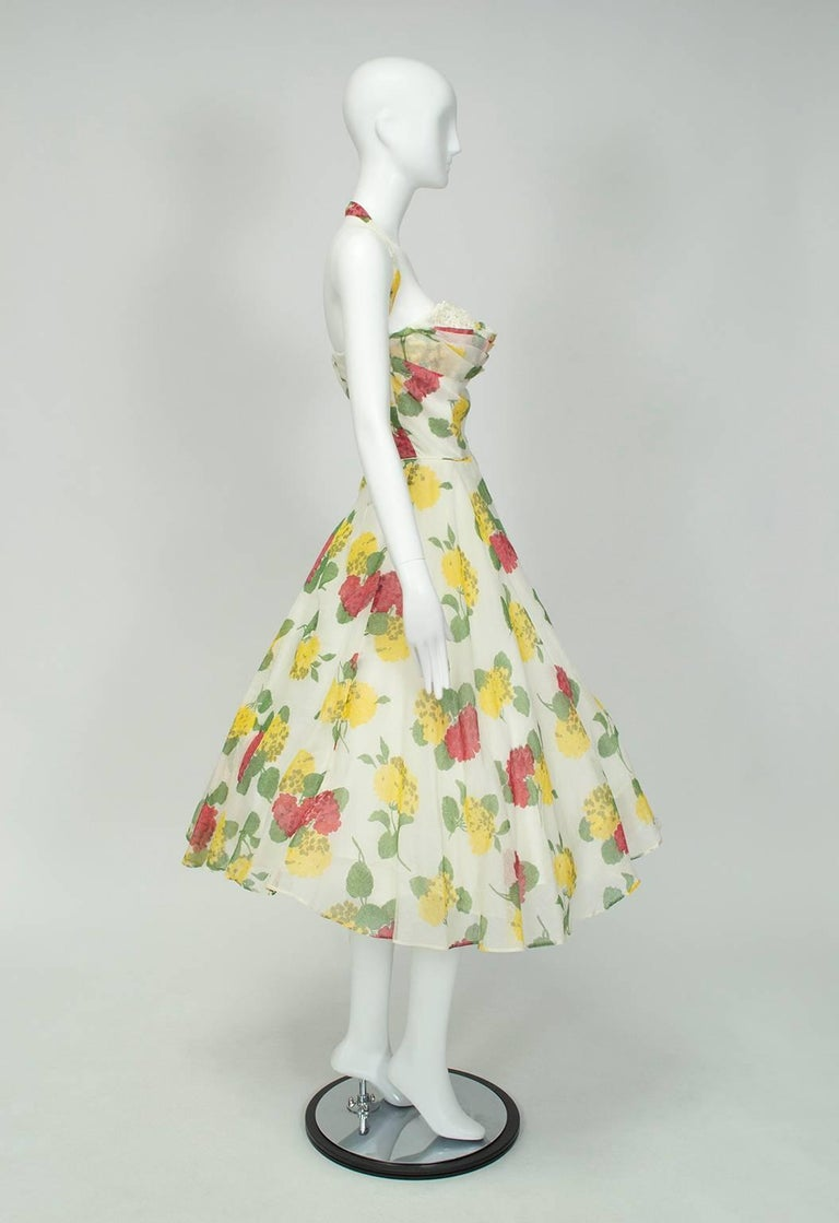 Wearable with a halter or strapless neckline, this romantic sundress would be the perfect ensemble for a breezy garden party or summer wedding. Ideal for larger busts, the ample shelf bustline also features a rhinestone-studded under-layer that