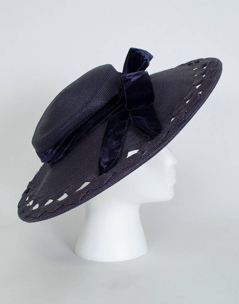 In impossible-to-find dark navy, this extra wide brimmed sun hat would a holy grail even WITHOUT the ultra-chic diamond voids in the brim. With them, it's a
