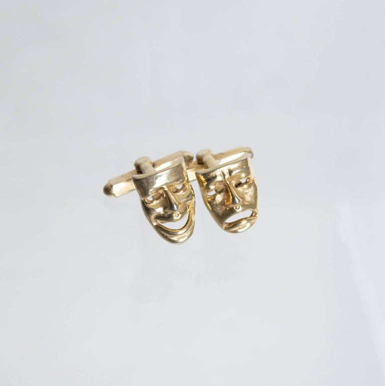 Comedy and Tragedy theater mask toggle cuff links of goldtone metal; convex profile. Material: goldtone metal noteworthy: polish with soft cloth alterations: none condition: near mint with very gentle surface wear   measurements:  width: