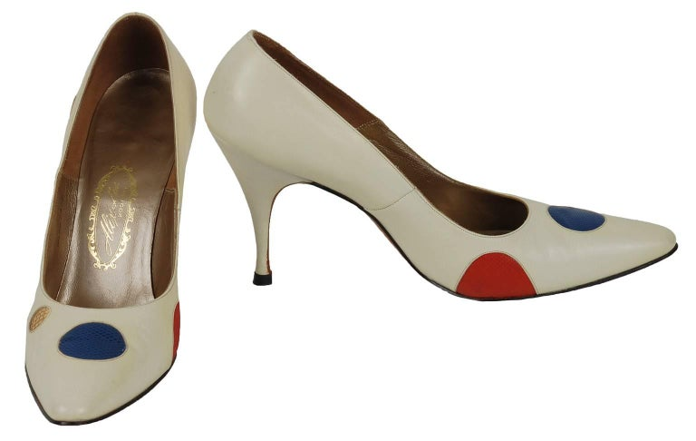 They may date from the 1950s, but they scream Eighties Nu Wave to us.  And thanks to polka dots in red, yellow, blue, green AND gold you can wear them with all the eras in between.  Ivory leather pointed toe pump inset with multicolored reptile skin