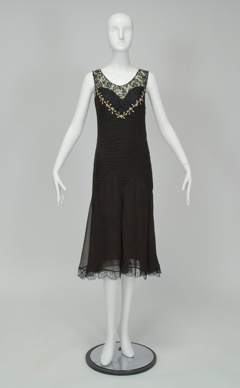 Unlike many 1920s dresses, the embellishment on this piece may not be immediately obvious. Closer inspection reveals that the dropped bodice is actually entirely horizontally pintucked and joined to the skirt with a zigzag waist seam. A fetching