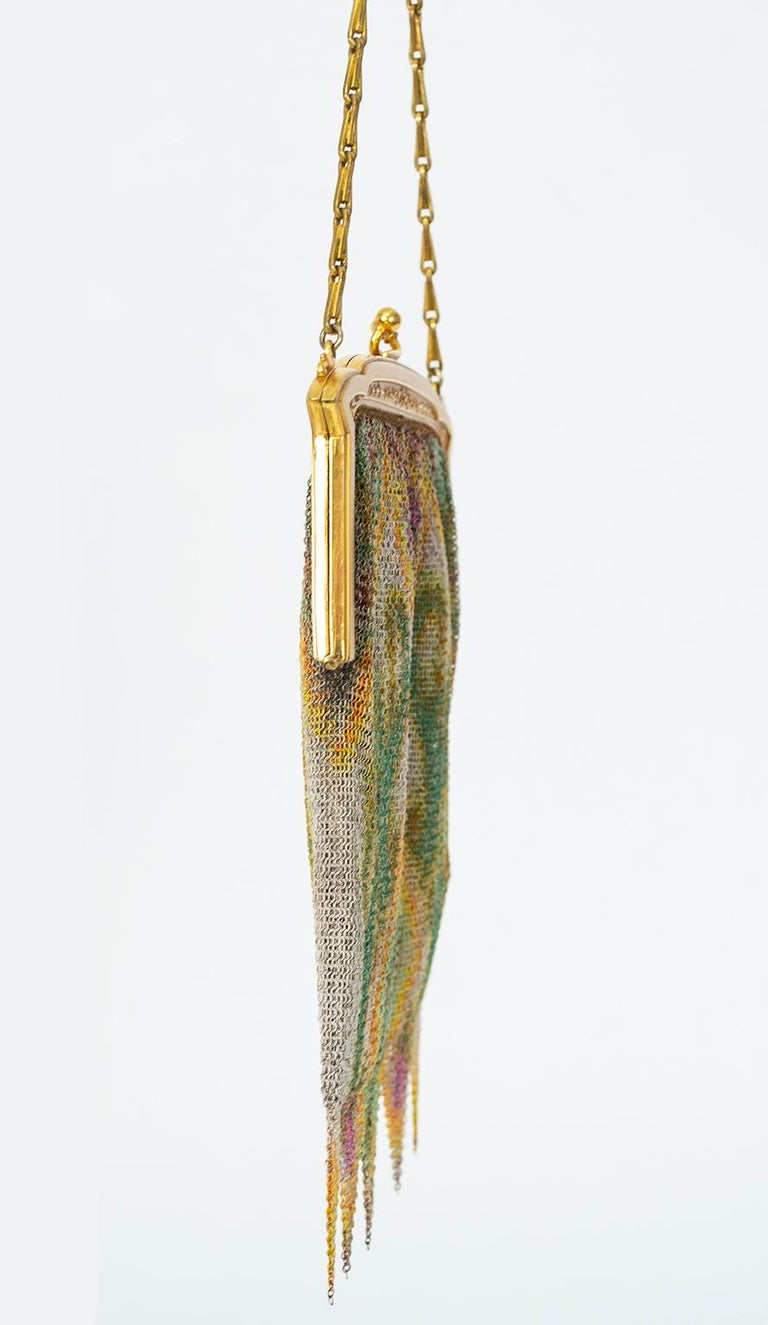 Demure pointed fringe and an Impressionist watercolor print are the perfect counterpoint to a flapper dress unsafe to take home to mother. Just large enough for a credit card and some lipstick, because a nice girl kept her flask in her garter.  Fine