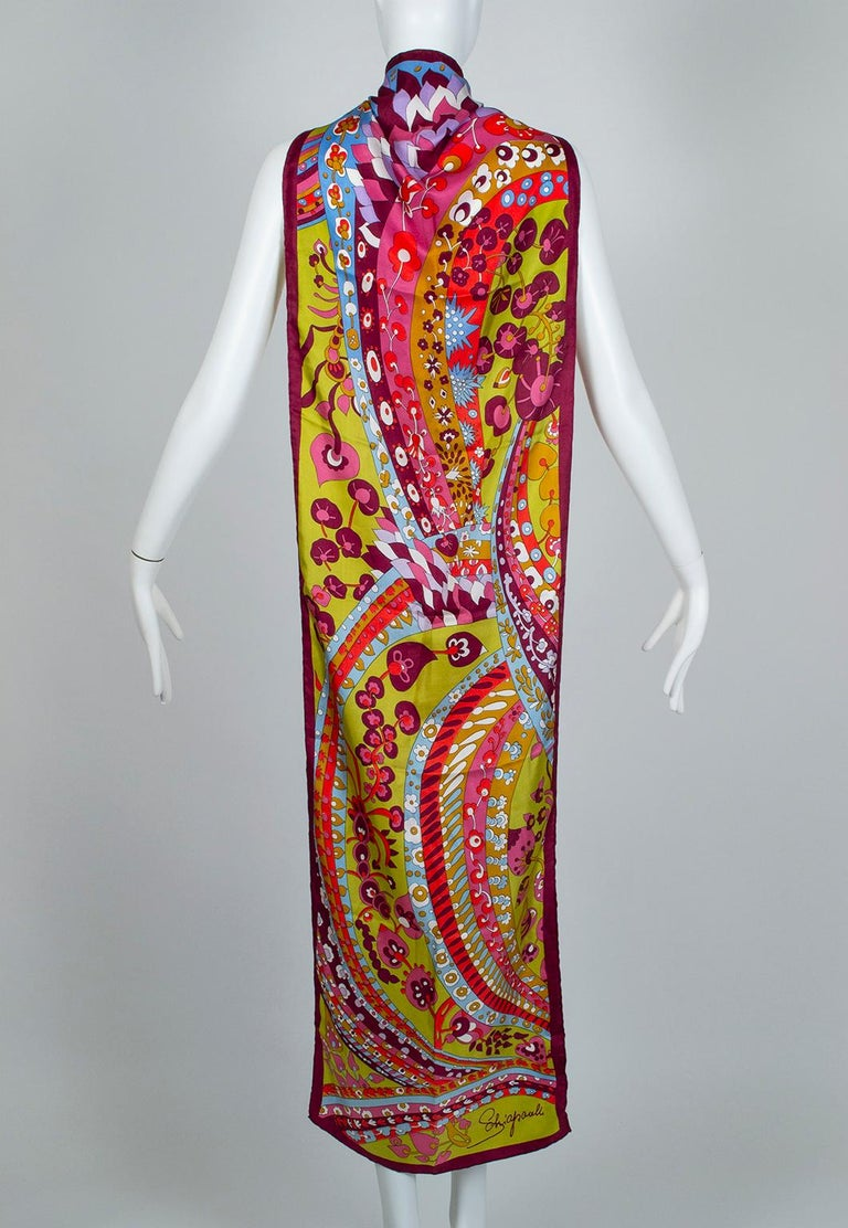 Apparently Elsa Schiaparelli enjoyed a psychedelic streak in addition to her penchant for Surrealism. This scarf--wearable in the hair, around the neck or shoulders, or even as a belt--is so similar to a Peter Max or Bonnie Maclean lithograph you