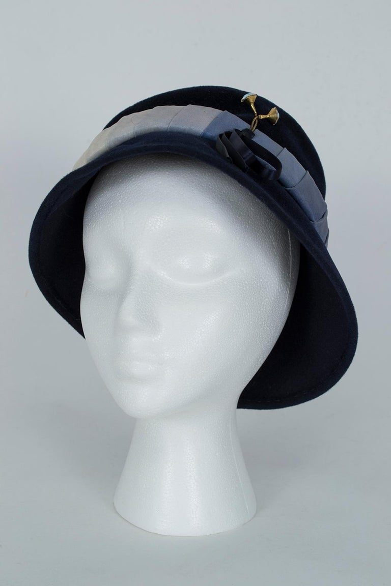 Made by one of the finest French milliners of the mid-20th century, this immaculate bucket hat offers all the style of a cloche, the warmth of a brim and the insouciance of a floppy together with an up-to-the-minute ombré band. Ideal for fall and