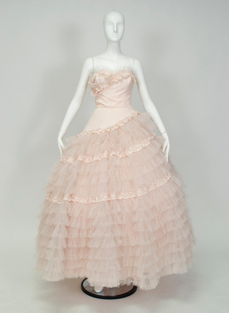 A confection of a gown, from its color to its spiral texture to its 27-foot sweep. Breathtakingly feminine, this dress literally and figuratively dominates every room it enters, and thanks to its whisper pink color it would make a devastating