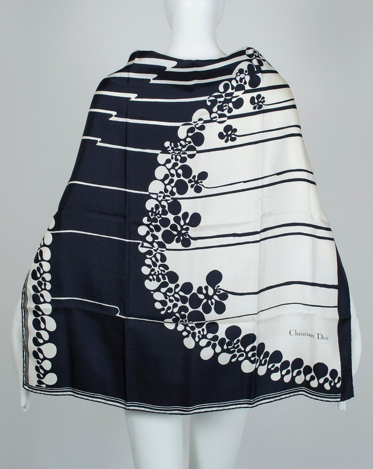 Stark black and white lines and curves embellish this oversized square scarf, large enough to wear around the shoulders, in the hair or on your handbag. Pretty enough to frame!  Single-ply silk twill scarf with rolled edges. Square format features