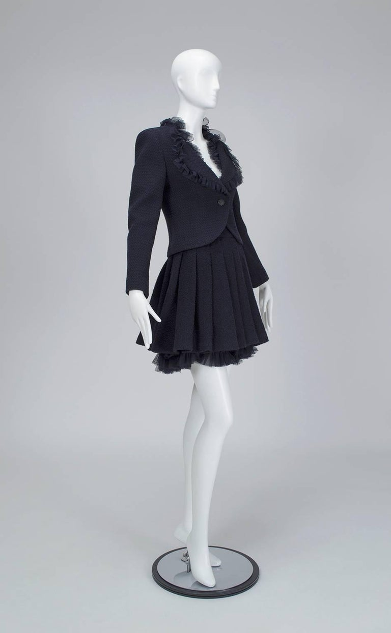 Though Chanel made its name on the lean drop waist dress suits of the 1920s, the brand has also produced garments that break their traditional mold and yet remain unmistakably