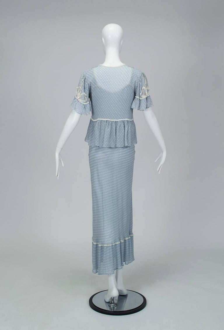 To find a matching nightgown and bed jacket of such featherweight chiffon in perfect condition is unheard of, yet here is proof. In soft cornflower blue, the body-skimming set balances innocence and allure and belongs floating down a curved