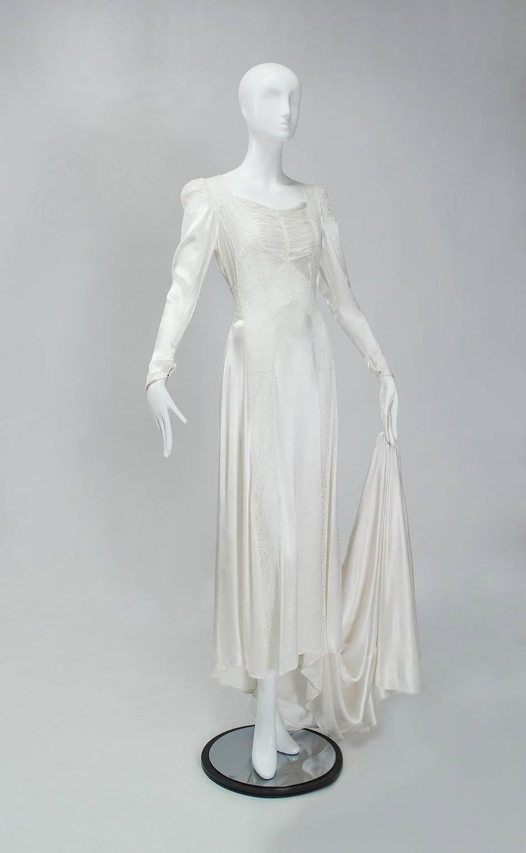 You would be forgiven for thinking this is an uptight wedding gown because of its age and sleeves. Of course we would direct your attention to the transparent lace insets that discourage the use of underwear.  Vintage long sleeve bright white bias