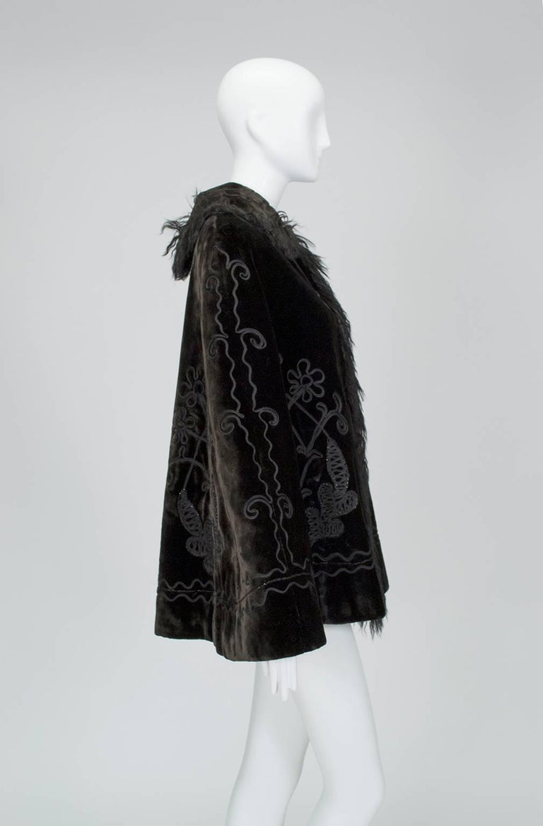 With enough body to stand on its own, this capelet flares so much when worn that none of the embroidered jet detail is obscured. Though the mohair is actually chocolate brown, it's plush enough to look black at certain angles. Exquisite quality
