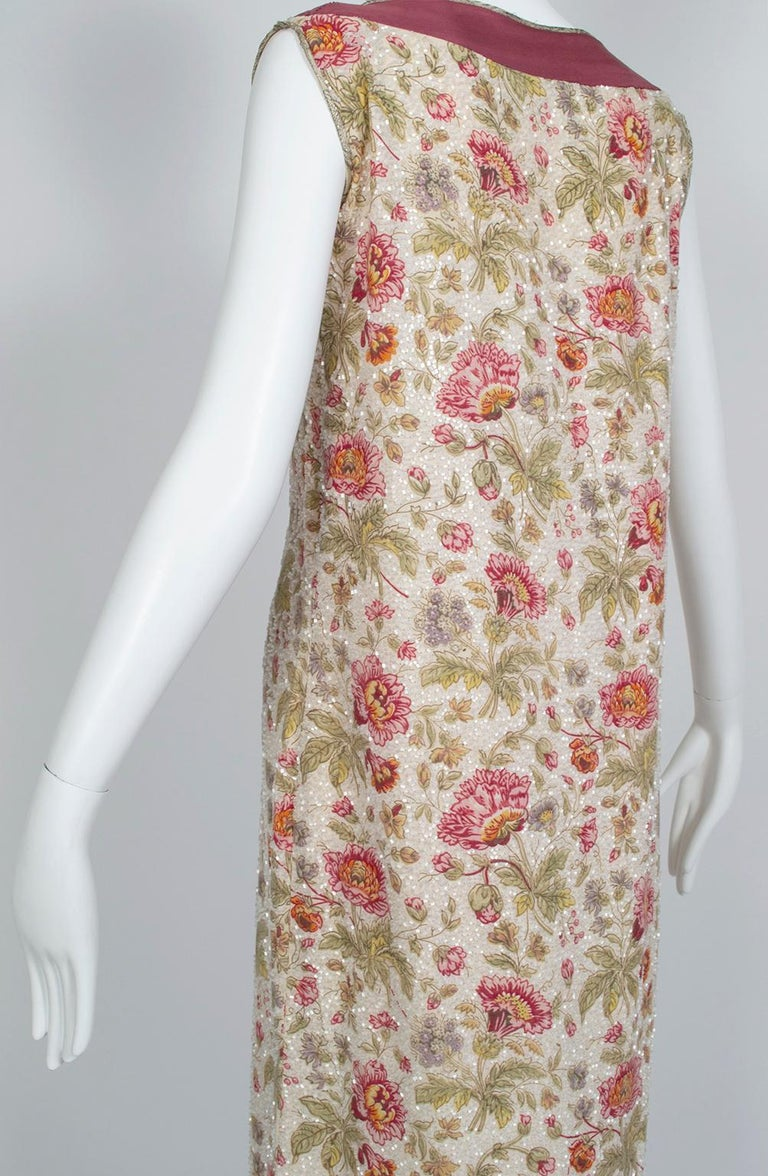 A rare larger size for a Jazz Age garment, this incredible dress offers the comfort of a shift with the elegance of formalwear thanks to its lustrous glass beads. We love how the flowers are left unbeaded for extra depth and texture. Areas where