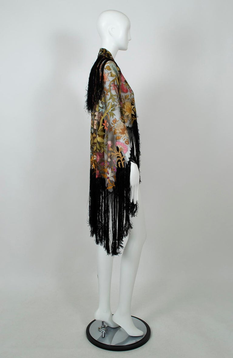 Despite being over a century old, this intricate mantilla is as colorful and perfect as the day it was made. Similar in complexity to a piano shawl but half the traditional size (and twice as delicate) it is one of the most exquisite we have ever
