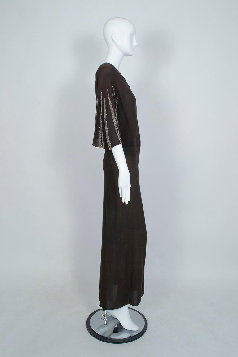 Dignified and statuesque, this gown combines the modesty and rigor of a kimono with the body conscious glamour of the 1930s. The high cut asymmetrical bodice and inset obi waist detail keep it demure, but the fluttering batwing sleeves—dripping with