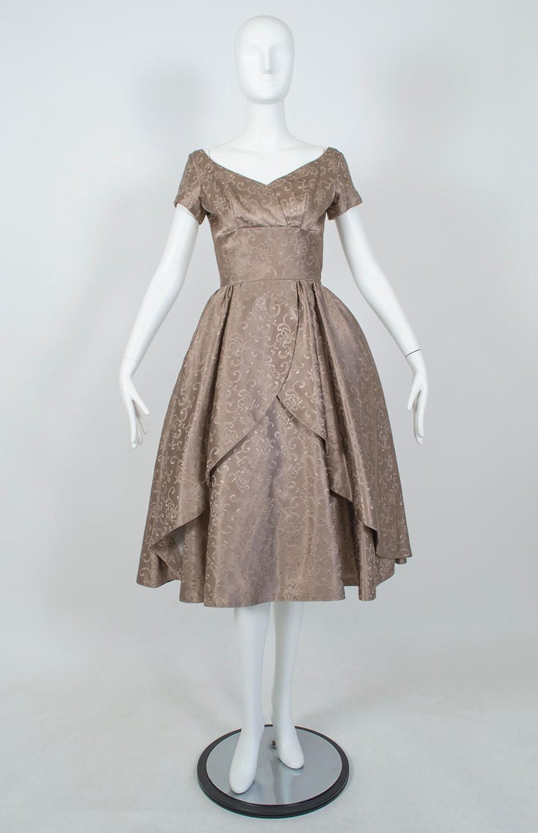From the estate of a mid-century opera singer comes this New Look party dress, which looks like it might have stepped out of a Henry Clarke fashion shoot. High fashion touches like a cummerbund waist and cutaway skirt are complemented by thoughtful