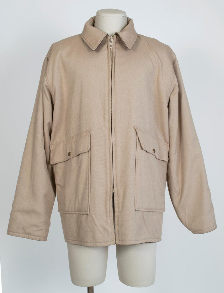 From the estate of an avid hunter and fly fisherman, this reversible field jacket is the real thing, complete with flap pockets for tackle, handwarmer pockets for warmth and a zippered through-pocket in the back for your catch. Luxuriously heavy and