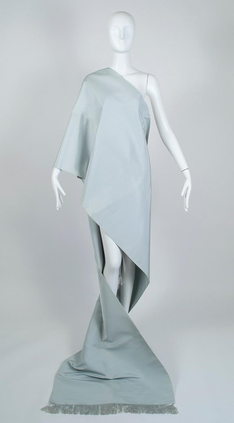 One of Jacqueline Kennedy Onassis's favorite designers, Gustave Tassell was known for his ultra-simple, yet powerfully classic looks.  To wit: this piece is one of his scarves, but its massive size (over 13 feet!) and opulent fabric provide endless