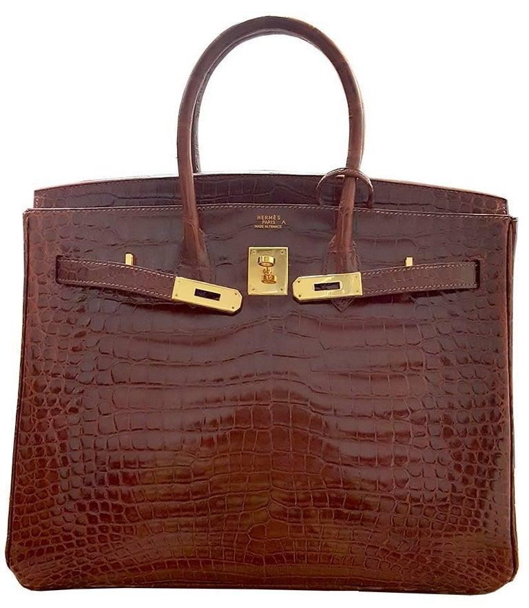 HERMES 35cm Red Orange  Crocodile Birkin Bag 100% Authentic Hermes Birkin Bag COLOR: Bourgogne MATERIAL: Porosos Crocodile HARDWARE: Gold Plated ORIGIN: France CONDITION: Pristine INCLUDES: dustbag, clochette, lock, and key.