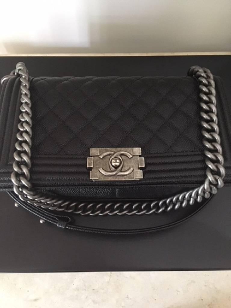 Black Chanel Medium Boy Bag in Caviar leather  For Sale