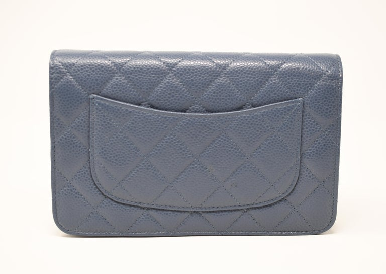 Classic Chanel chain shoulder bag in a gray/blue caviar quilted leather.  Features optional silver chain shoulder strap.  Silver CC on the front of the bag.  Credit card slots on the inside.  Condition: New with tags and comes in original box with