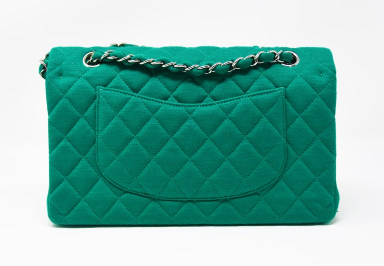 Classic Chanel chain shoulder bag in emerald green knit jersey with leather interior.  Silver hardware with chain shoulder strap.  Medium size double flap bag in a very rare knit jersey.  Condition: New with tags.  Comes in original Chanel box with