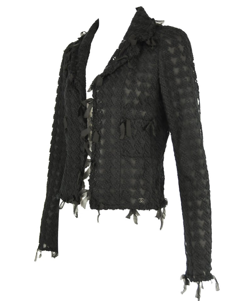 Stunning embroidered houndstooth on black tulle. This fabric is truly incredible.  Chiffon bias strips hang off the edges of this jacket.  Features a peak lapel collar.   Size: FR 36  Condition: New item with original Chanel tags  Composition: 72%