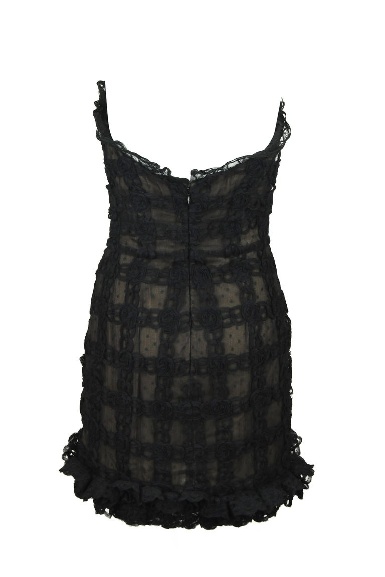 Incredible lace detail on this vintage Chanel strapless dress.  A very special piece that will certainly impress at any cocktail party or formal function.  Intricate lace detail with Chanel CC logo in rhinestones on the hip.   Size: FR