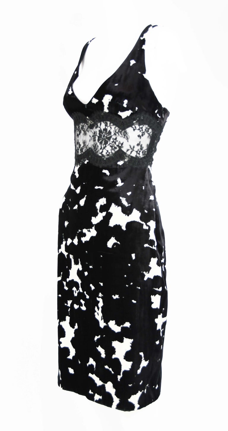 Fitted, sleeveless Versace black and white pattern dress in gorgeous velvet with a low v neck.  Lace insert under bust.  Perfect cocktail party attire.  Size: IT 42  Condition: Excellent condition  Composition: 81% rayon, 18% silk, 1% nylon  Care: